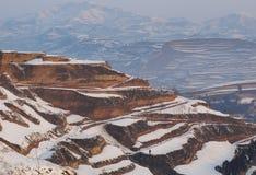 Terassenförmig angelegtes Feld des Schnees Stockfotografie
