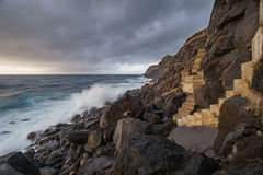 Terceira island coastline with stairs and waves breaking, long exposure Stock Photography