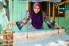 Terengganu songket weaver. AUGUST 01: Along Ngah, a traditional Songket weaver does a demonstration on the porch of his house at 2011 on August 01, 2011 in Kuala royalty free stock photos