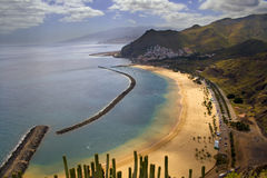 Teresitas Beach Tenerife. A view of Teresitas beach with San Andres on the hill side and mount Teide in the back ground stock photos