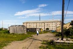 Teriberka, Russia - July 25, 2017: Woman walking down the street in Russian village Teriberka in Kolsky District of Murmansk stock photos