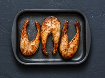 Teriyaki baked salmon in asian style on a baking tray. Healthy  fats food, dark background Stock Image