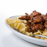 Teriyaki Beef and Noodles. On white place isolated on White stock image