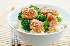 Teriyaki chicken and broccoli stir fry with rice Stock Photo