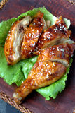 Teriyaki Chicken. With classic wooden background. Teriyaki is a cooking technique used in Japanese cuisine in which foods are broiled or grilled with a glaze of stock images