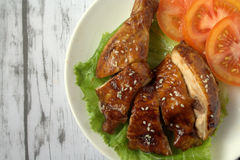 Teriyaki Chicken. With classic wooden background. Teriyaki is a cooking technique used in Japanese cuisine in which foods are broiled or grilled with a glaze of royalty free stock images