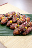 Teriyaki Chicken Midwing. Teriyaki chicken mid wing on a banana leaf Royalty Free Stock Photo