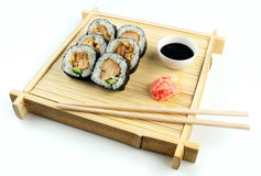 Teriyaki chicken sushi on rustic bamboo tray with soy sauce and pickled ginger Stock Photo