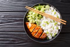 Free Teriyaki Chicken With Rice Garnish And Salad Close-up On A Plate. Horizontal Top View Stock Images - 150903344