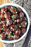 Teriyaki Meatballs. Beef meatballs in a Teriyaki glaze with sesame seeds and green onions stock photography