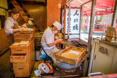 Teriyaki Nakamise-dori Asakusa. Tokyo, Japan - April 19, 2017: chef making japanese teriyaki famous dessert on Nakamise-dori, a street with food and souvenirs Royalty Free Stock Image