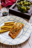 Teriyaki salmon with corn and Brussels sprouts royalty free stock photos