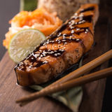 Teriyaki salmon with rice on a wooden platter. Top Royalty Free Stock Images