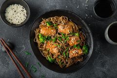 Teriyaki salmon and soba noodle served with sesame seeds and chi. Ves, top view Stock Photo