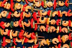 Teriyaki shrimp kebab on black baking Stock Images
