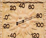 Termómetro con la cara de Sun Imagen de archivo libre de regalías
