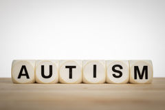 Term Autism spelled out with toy dice Royalty Free Stock Photo