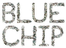 Blue Chip - Crimped 100$ Bills. The term 'blue chip', made out of crimped 100$ bills. 'Blue Chip' is a stock market term, which refers to a stock of a large and Royalty Free Stock Photos