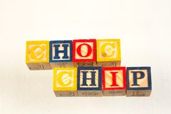 The term choc chip visually displayed. Using colorful wooden toy blocks on a white background image with copy space in landscape format royalty free stock photography