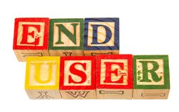 The term end user visually displayed. On a white background using colorful wooden toy blocks image in landscape format with copy space Stock Photo