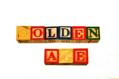 The term golden age visually displayed on a white background. Using colorful wooden toy blocks in landscape format with copy space Stock Photo