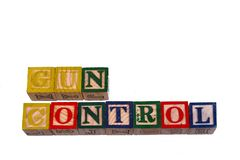 The term gun control visually displayed on a white background. Using colorful wooden toy blocks, image in landscape format with copy space Royalty Free Stock Photography