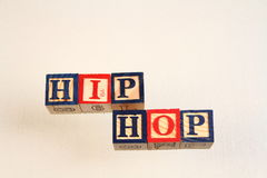 The term hip hop displayed visually. Using colorful wooden blocks on a white background in landscape format with copy space Stock Photography