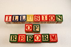 The term illusion of reform. Visually displayed on a white background using colorful wooden toy blocks in landscape format with copy space Stock Photos