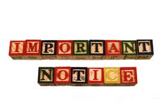 The term important notice visually displayed on a white background. Using colorful wooden toy blocks in landscape format with copy space Stock Photography