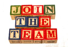 The term join the team over visually displayed. On a white background using colorful wooden toy blocks image in landscape format with copy space Stock Images