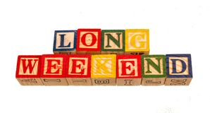 The term long weekend visually displayed. On a white background using colorful wooden toy blocks image in landscape format with copy space Stock Image