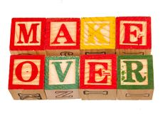 The term make over visually displayed. On a white background using colorful wooden toy blocks image in landscape format with copy space Royalty Free Stock Images