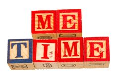 The term me time visually displayed. On a white background using colorful wooden toy blocks image in landscape format with copy space Royalty Free Stock Photography