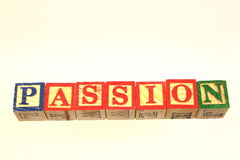 The term passion. Displayed visually using colorful wooden toy blocks Stock Photo