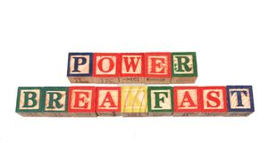 The term power breakfast visually displayed on a white background. The term power breakfast visually displayed using colorful wooden toy blocks on a white Royalty Free Stock Photography