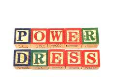 The term power dress visually displayed on a white background. The term power dress visually displayed using colorful wooden toy blocks on a white background Stock Photography