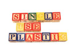 The term single use plastic visually displayed on a white background. The term single use plastic visually displayed using colorful wooden toy blocks on a white Stock Images