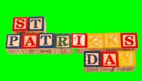 The term St Patrick`s Day on an emerald green background. The term St Patrick`s Day visually displayed on an emerald green background using colorful toy blocks Stock Photos