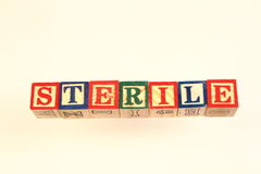 The term sterile displayed visually. Using colorful wooden blocks on a white background in landscape format with copy space Royalty Free Stock Photography