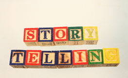 The term story telling. Displayed visually on a white background using colorful wooden toy blocks Stock Photography