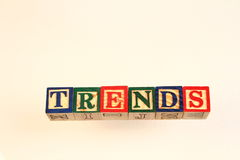 The term trends displayed visually. Using colorful wooden blocks on a white background in landscape format with copy space Royalty Free Stock Photography