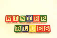 The term winter blues. Visually displayed using colorful wooden blocks stock photo
