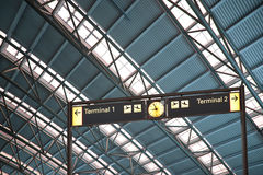 Terminal 1 and 2 signs in airport interior Royalty Free Stock Images