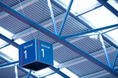 Terminal 1 sign in airport interior Stock Images