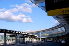 Terminal. Airport terminal with cars outside and bright blue sky Stock Photo