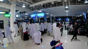 Terminal airport in Dubai. Arab sheikhs and women in burqa walk inside the terminal. DUBAI, UNITED ARAB EMIRATES, DECEMBER 10, 2017: Terminal airport in Dubai stock video footage