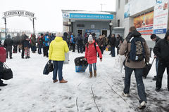 Terminal airport Petropavlovsk-Kamchatsky City (Yelizovo airport). Kamchatka, Far East Russia. PETROPAVLOVSK, KAMCHATKA, RUSSIA - MARCH 19, 2015: Passengers in Stock Photography