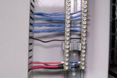 Terminal block. Closeup. Multi colored wires. Royalty Free Stock Images