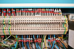 Terminal block with connected colored numbered wires. stock images