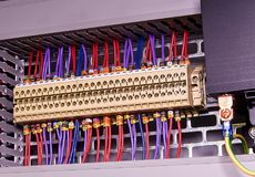 Terminal blocks for electrical connection and earthing terminals for grounding in the control cubicle. Wires with Royalty Free Stock Photo